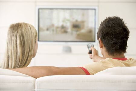 cosy: Couple in living room watching television