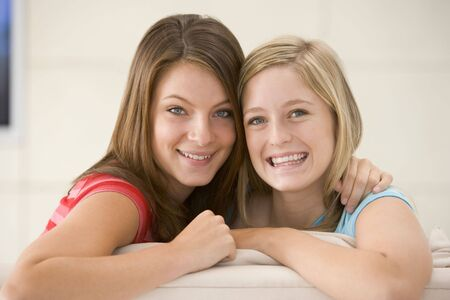 Two women in living room smiling photo