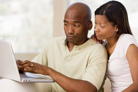 offset angle: Couple in living room using laptop