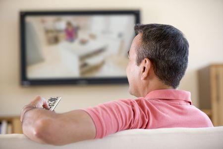 Man in living room watching television photo