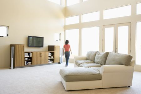 Woman walking through living room photo