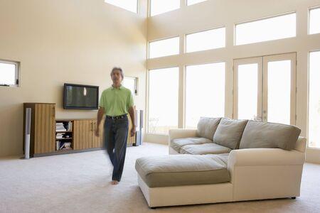 hi fi: Man walking through living room