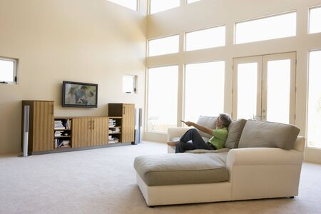 hi fi: Man in living room watching television