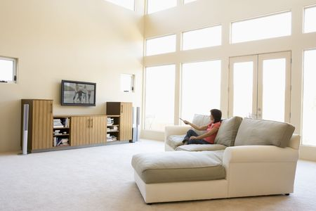Woman in living room watching television photo