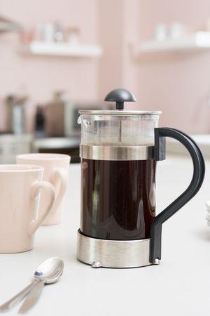 kitchen counter: Coffee pot on kitchen counter