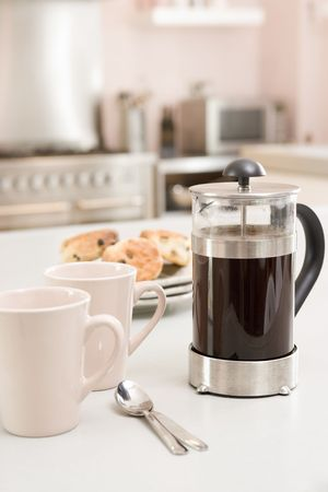countertop: Coffee pot on kitchen counter with scones Stock Photo