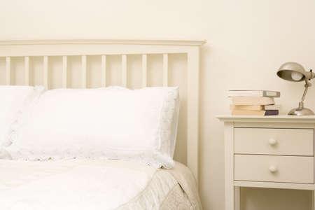 bedlinen: Empty bedroom with books on nightstand