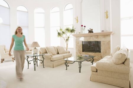 hearth and home: Woman walking through living room