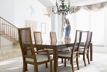 Woman in dining room smiling Stock Photo - 3485302
