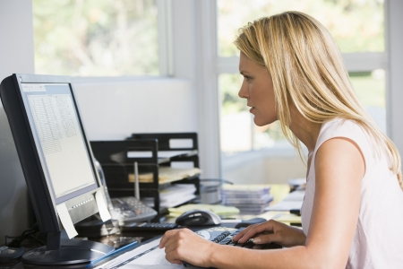 Woman in home office with computer photo