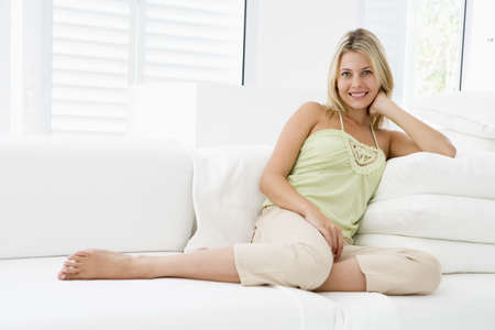 Woman sitting in living room Stock Photo