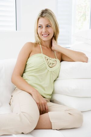 Woman sitting in living room photo