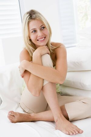 Woman sitting in living room Stock Photo - 3484721
