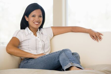 filipino people: Woman sitting in living room Stock Photo