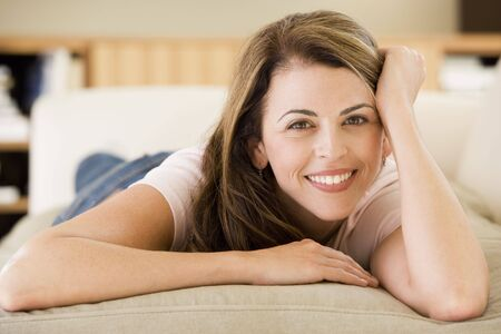 Woman lying in living room Stock Photo - 3485292