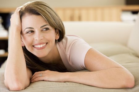 Woman lying in living room photo