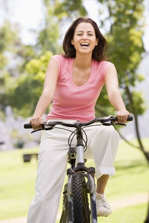 30s: Woman on bicycle smiling