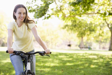 Woman on bicycle smiling Stock Photo - 3485438