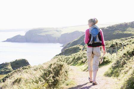 rambling: Woman walking on cliffside path
