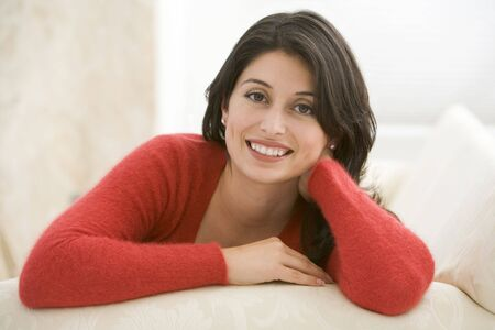 30s: Woman sitting in living room Stock Photo