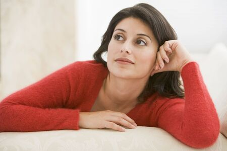 generation x: Woman sitting in living room Stock Photo
