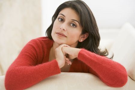 30s adult: Woman sitting in living room Stock Photo