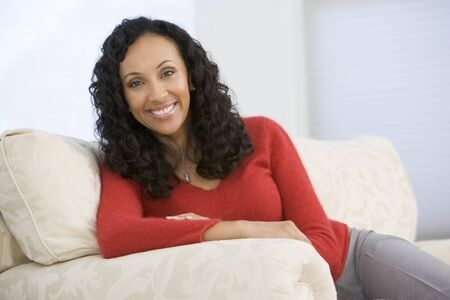 Woman sitting in living room Stock Photo - 3484668