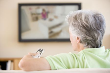 Man watching television using remote control Stock Photo - 3482440