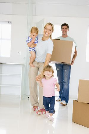 Family with box moving into new home smiling Stock Photo - 3485855