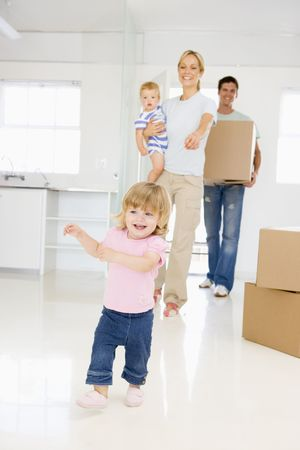 Family with box moving into new home smiling Stock Photo - 3485768