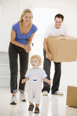 Family moving into new home smiling photo
