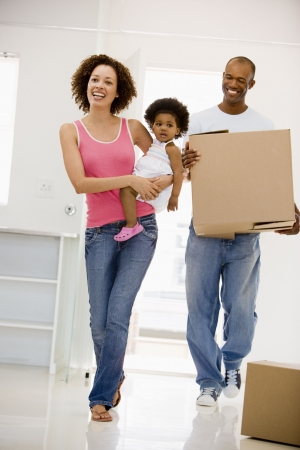 Family moving into new home smiling Stock Photo - 3486927