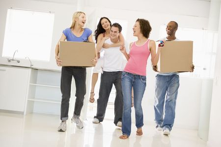 Group of friends moving into new home smiling photo