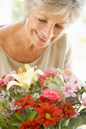 Woman with flowers smiling photo