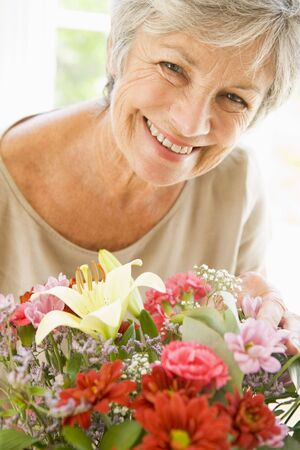 Woman with flowers smiling Stock Photo - 3487254