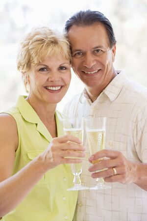 Couple toasting champagne and smiling Stock Photo - 3486945