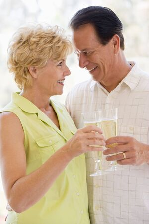 Couple toasting champagne and smiling Stock Photo - 3487096