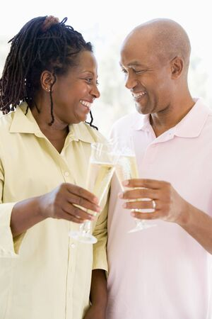 Couple toasting champagne and smiling Stock Photo - 3487283