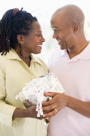 Husband and wife holding gift smiling Stock Photo - 3487506