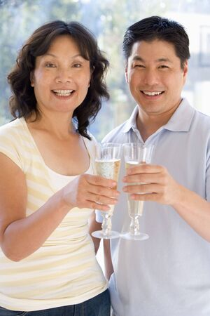 Couple toasting champagne and smiling Stock Photo - 3488127