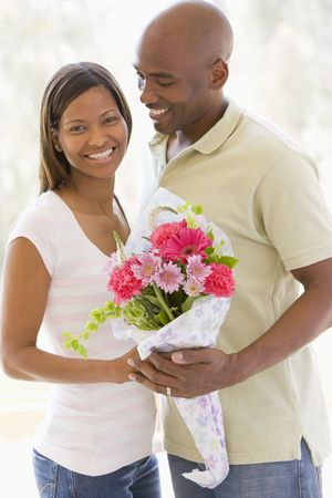 Husband and wife holding flowers and smiling Stock Photo - 3488109