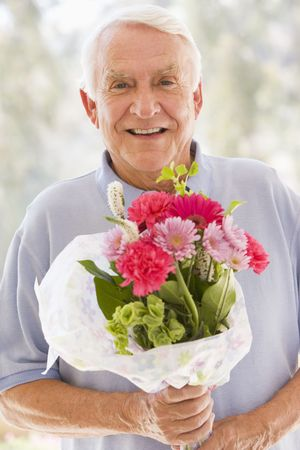 Man holding flowers and smiling photo