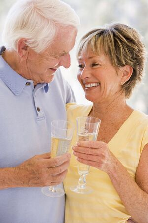 Couple drinking champagne and smiling photo
