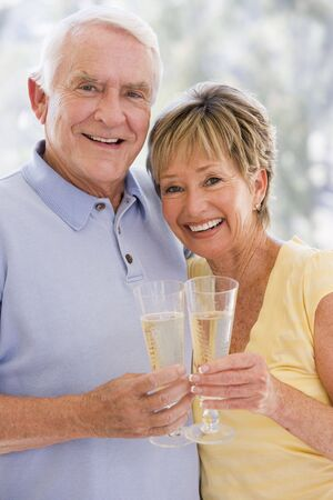 Couple toasting champagne and smiling Stock Photo - 3488201