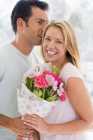 Husband and wife holding flowers and smiling Stock Photo - 3487291