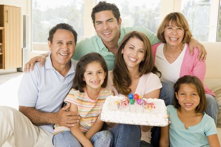 Family in living room with cake smiling Stock Photo - 3487501