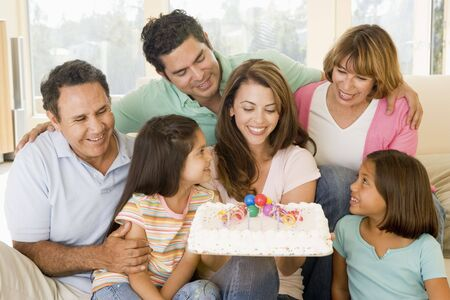 Family in living room with cake smiling Stock Photo - 3488154