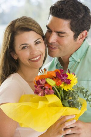 Husband and wife holding flowers and smiling Stock Photo - 3488077