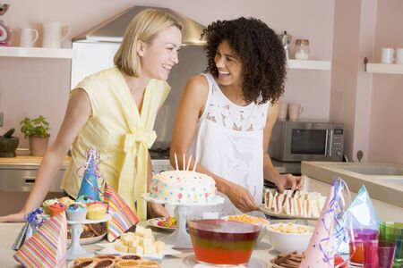 Two women at party getting sandwiches smiling Stock Photo - 3487282