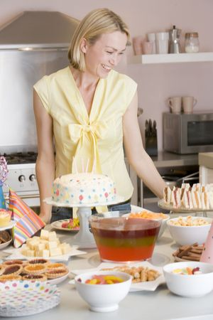 Woman at party standing by food table smiling Stock Photo - 3486711